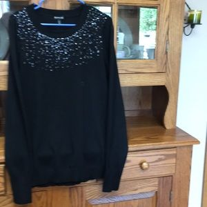 Black sweater black embellishment.